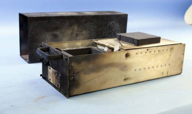 This photo released Tuesday, June 3, 2014, by the National Transportation Safety Board in Washington, shows the flight data recorder, also known as a black box, recovered from the private jet destroyed in a fiery crash Saturday night at Hanscom Field in Bedford, Mass. Philadelphia Inquirer co-owner Lewis Katz and six others were killed in the crash. (AP Photo/National Transportation Safety Board)