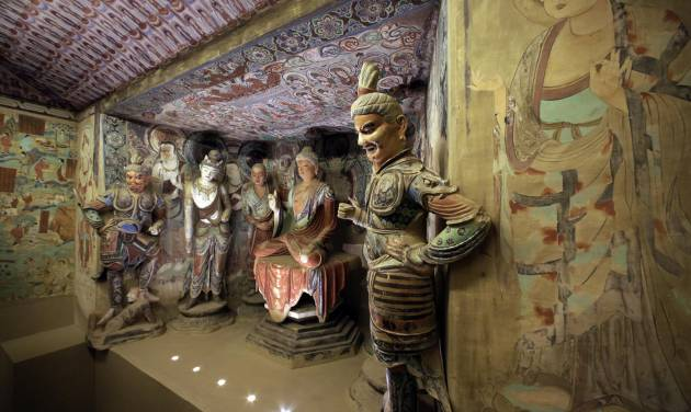 "A full scale replica cave from the 8th century that contains the Bodhisattva of the Mogao Caves is presented in ""Dunhuang: Buddhist Art at the Gateway of the Silk Road,"" at the China Institute, in New York,  Tuesday, April 24, 2013. (AP Photo/Richard Drew)"