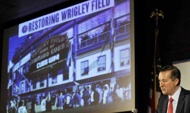 FILE - In this May 1, 2013, file photo, Chicago Cubs Chairman Tom Ricketts speaks in Chicago about proposed renovations at Wrigley Field. The owners of the Chicago Cubs say they're moving forward with plans to renovate and expand Wrigley Field, despite the threat of lawsuits by the owners of the adjacent rooftop venues overlooking the 100-year-old ballpark. Ricketts, whose family owns the north-side Chicago team, said Thursday, May 22, 2014 that the Cubs will submit a revised expansion plan to the Commission on Chicago Landmarks that includes the team's original proposal to add several outfield signs and additional bleacher seats. (AP Photo/Paul Beaty, File)