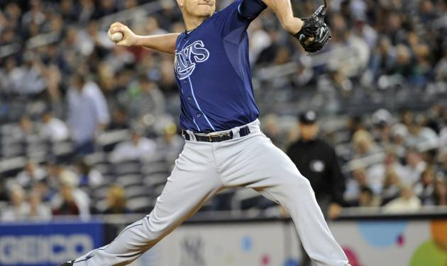 Tampa Bay Rays pitcher Alex Cobb delivers the ball to the Tampa Bay Rays during the first inning of a baseball game Thursday, Sept. 26, 2013, at Yankee Stadium in New York. (AP Photo/Bill Kostroun)