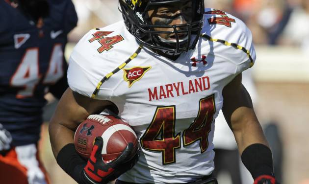 Maryland running back Justus Pickett (44) heads to the end zone for a score during an NCAA college football game at Scott Stadium in Charlottesville, Va., Saturday, Oct. 13, 2012. (AP Photo/Steve Helber)