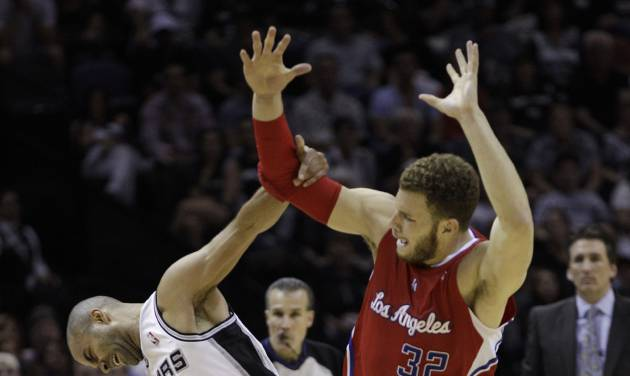 San Antonio Spurs' Tony Parker (9), of France, is fouled by Los Angeles Clippers' Blake Griffin (32) while moving the ball upcourt during the second quarter of Game 2 of an NBA basketball Western Conference semifinal playoff series on Thursday, May 17, 2012, in San Antonio. (AP Photo/Eric Gay)
