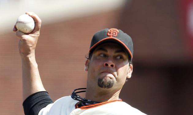 San Francisco Giants starting pitcher Ryan Vogelsong throws against the Pittsburgh Pirates in the sixth inning of a baseball game in San Francisco, Sunday, Aug. 25, 2013. (AP Photo/Tony Avelar)