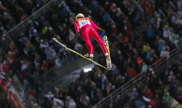Poland's Kamil Stoch makes his first attempt during the ski jumping large hill final at the 2014 Winter Olympics, Saturday, Feb. 15, 2014, in Krasnaya Polyana, Russia. (AP Photo/Dmitry Lovetsky)