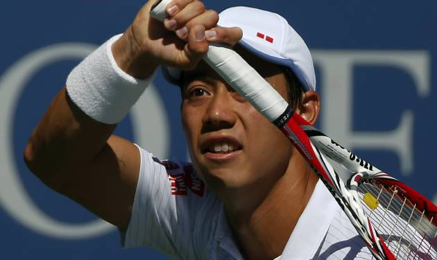 Kei Nishikori, of Japan, follows through on a shot to Pablo Andujar, of Spain, during the second round of the 2014 U.S. Open tennis tournament, Thursday, Aug. 28, 2014, in New York. (AP Photo/Matt Rourke)