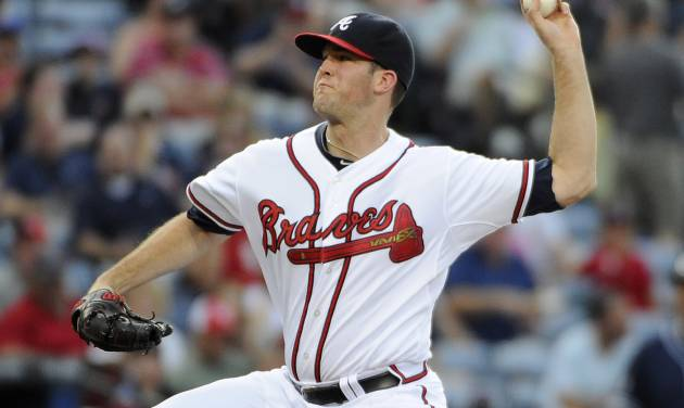 Atlanta Braves starting pitcher Alex Wood delivers to the San Diego Padres during the first inning of a baseball game Friday, July 25, 2014, in Atlanta. (AP Photo/David Tulis)