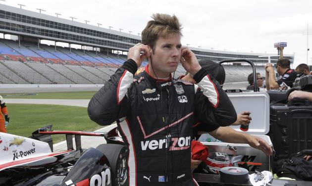 Will Power of Australia stands next to his car after qualifying for the pole position in the IndyCar auto racing at Texas Motor Speedway in Fort Worth, Friday, June 6, 2014. (AP Photo/Tim Sharp)