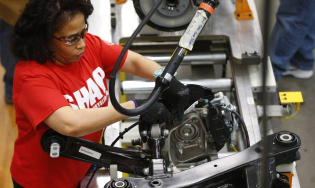 In this March 14, 2014 photo, an assembly line worker builds a 2015 Chrysler 200 automobile at the Sterling Heights Assembly Plant in Sterling Heights, Mich. The Commerce Department releases factory orders for May on Wednesday, July 2, 2014.  (AP Photo/Paul Sancya)