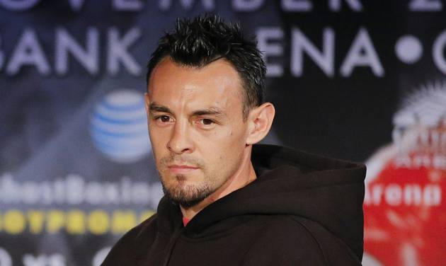 FILE - In this Oct. 23, 2012 file photo, boxer Robert Guerrero is photographed during a news conference in Los Angeles. Guerrero was arrested at New York's Kennedy Airport after police said he tried to bring a gun on a plane. Queens District Attorney Richard Brown said Guerrero was arrested Thursday, March 28, 2013, when he presented a locked gun box to a ticket agent during check-in. The 30-year-old Guerrero is the former featherweight champion and current WBC welterweight champion. (AP Photo/Jae C. Hong, file)