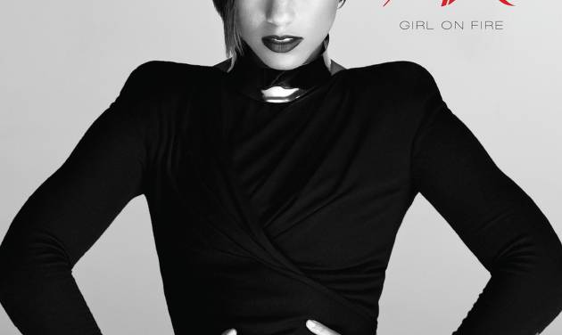 "This CD cover image provided by RCA Records shows the latest release by Alicia Keys, ""Girl on Fire."" It's her first release after her marriage to producer-rapper Swizz Beatz and the birth of their son Egypt. (AP Photo/RCA Records)"
