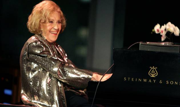 """FILE - In this March 19, 2008 file photo, Marian McPartland smiles while playing the piano during a celebration of her 90th birthday in New York. McPartland, 95, the legendary jazz pianist and host of the National Public Radio show """"Piano Jazz,"""" died of natural causes Tuesday, Aug. 20, 2013 at her Port Washington home on Long Island. (AP Photo/Seth Wenig, File)"""
