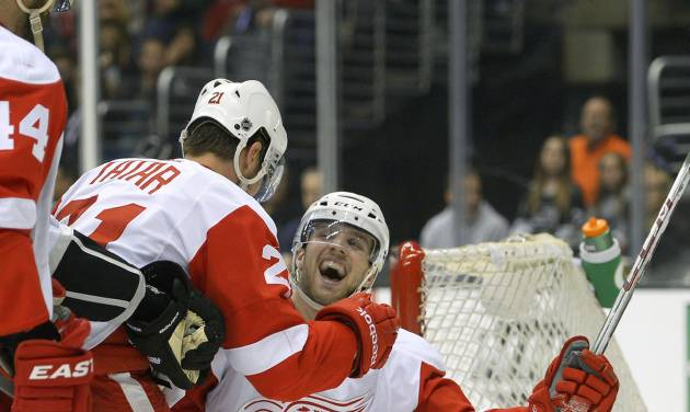 Detroit Red Wings center Riley Sheahan, right, celebrates his goal with left wing Tomas Tatar, of Slovenia, during the first period of an NHL hockey game against the Los Angeles Kings, Saturday, Jan. 11, 2014, in Los Angeles. (AP Photo/Mark J. Terrill)