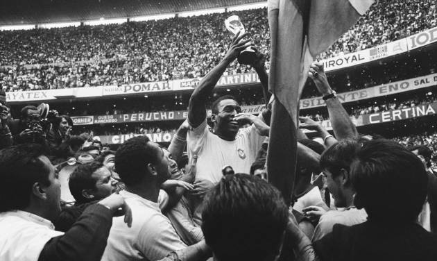 """FILE - The June 21, 1970 file photo shows Brazil's """"King"""" Pele as he has a big smile as he holds the Jules Rimet Trophy, following Brazil's victory over Italy in the World Cup final on June 21, 1970 at the Azteca Stadium, Mexico City. Brazil won 4-1 and was given the Jules Rimet Trophy permanently in recognition of its third victory. (AP Photo)"""