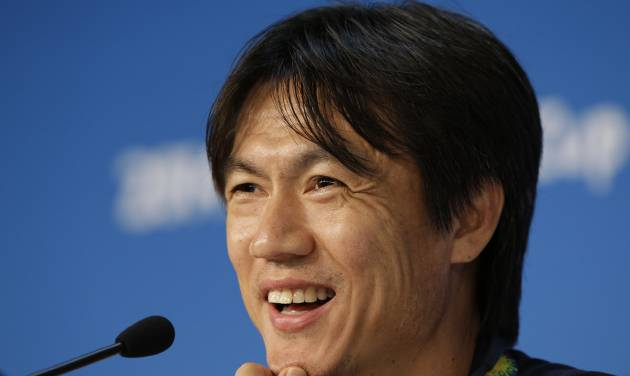 South Korea national soccer team coach Hong Myung-bo smiles while he answers reporter's question during a press conference the day before the group H World Cup soccer match between Russia and South Korea at the Arena Pantanal in Cuiaba, Brazil, Monday, June 16, 2014. (AP Photo/Lee Jin-man)