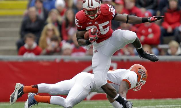 Wisconsin running back Melvin Gordon (25) runs over UTEP defensive back DeShawn Grayson during the first half of a NCAA college football game, Saturday, Sept. 22, 2012, in Madison, Wis. (AP Photo/Andy Manis)