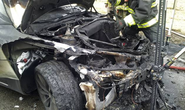In this Wednesday, Nov. 6, 2013 photo provided by the Tennessee Highway Patrol, emergency workers respond to a fire on a Tesla Model S electric car in Smyrna, Tenn. Spokeswoman Liz Jarvis Shean says Tesla has sent a team to Tennessee to investigate the fire. Two other Model S cars have caught fire in the past five weeks, one near Seattle and the other in Mexico. (AP Photo/Tennessee Highway Patrol)
