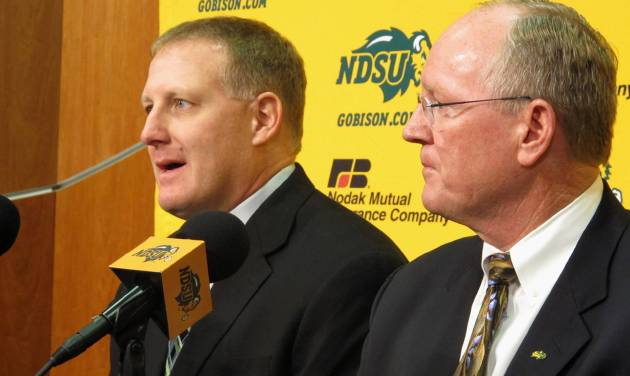 FILE - In this Dec. 15, 2013 file photo, North Dakota State defensive coorindator Chris Klieman, left, and athletic director Gene Taylor talk about Klieman's promotion to head coach during a news conference in Fargo, N.D. Klieman has named his offensive and defensive coordinators and several other coaches as he takes over for Craig Bohl, who is leaving for Wyoming after leading the Bison to three straight Football Championship Subdivision titles. (AP Photo/Dave Kolpack, File)