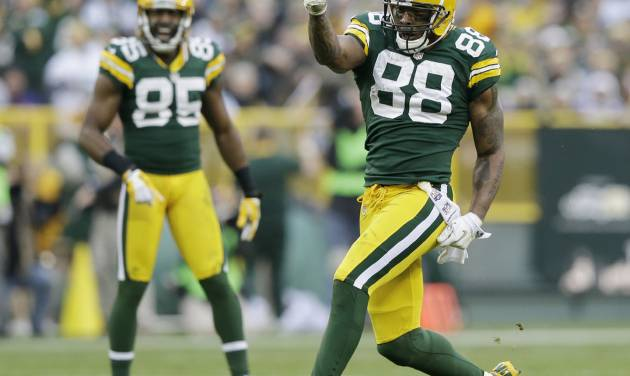 Green Bay Packers' Greg Jennings (85) watches as Jermichael Finley (88) celebrates a catch during the second half of an NFL football game against the Minnesota Vikings Sunday, Dec. 2, 2012, in Green Bay, Wis. The Packers won 23-14. (AP Photo/Morry Gash)