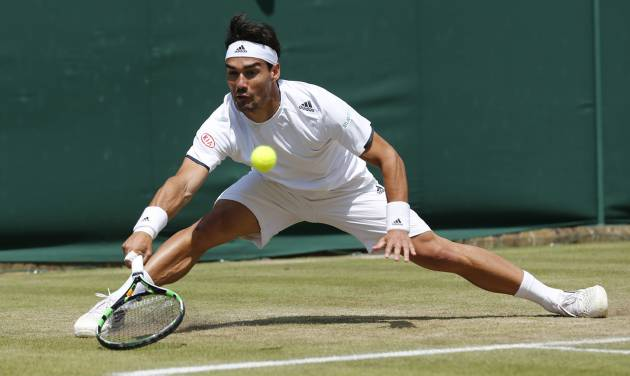 Fabio Fognini of Italy plays a return to Kevin Anderson of South Africa uring their men's singles match at the All England Lawn Tennis Championships in Wimbledon, London, Friday, June 27, 2014. (AP Photo/Ben Curtis)