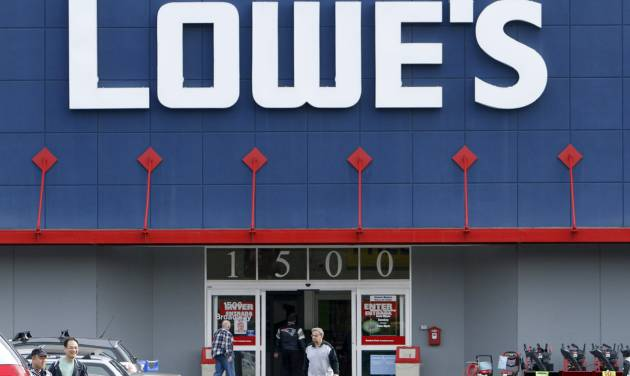 FILE -  In a Nov. 14, 2011 file photo customers enter and exit a Lowe's store in Saugus, Mass.  Home improvement retailer Lowe's Cos. said Monday, Feb. 25, 2013, cleanup efforts after Superstorm Sandy and its new pricing strategy helped its fourth-quarter net income surpass expectations.  (AP Photo/Michael Dwyer, file)