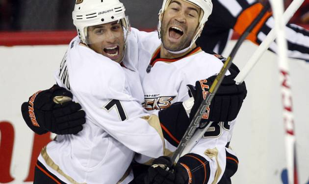 Anaheim Ducks' Daniel Winnik, right, celebrates his goal against the Calgary Flames with Andrew Cogliano during the third period of their NHL hockey game, Monday, Jan. 21, 2013, in Calgary, Alberta. The Ducks won 5-4. (AP Photo/The Canadian Press, Jeff McIntosh)