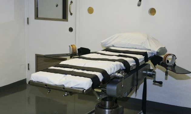 FILE - In this April 15, 2008 file photo, the gurney in the execution chamber at the Oklahoma State Penitentiary is pictured in McAlester, Okla. A report on a problematic execution in Oklahoma shows lethal drugs caused the inmate to die, not a heart attack, after the state's prisons chief halted efforts to kill him. (AP Photo/File)