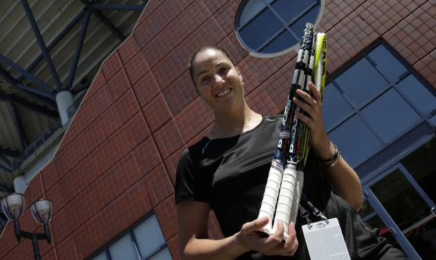 Alisa Kleybanova poses for a photo a day before the US Open tennis tournament starts, Sunday, Aug. 25, 2013, in New York. Kleybanova, a former top-20 player, is recovering from cancer. (AP Photo/Charles Krupa)