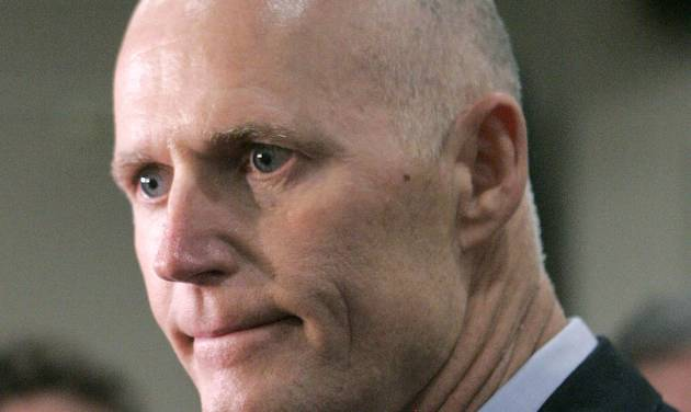 """FILE - This June 28, 2012 file photo shows Florida Gov. Rick Scott in Tallahassee, Fla. From the South to the heartland, cracks are appearing in the once-solid wall of Republican resistance to President Barack Obama's health care law. One of the most visible opponents of Obama's overhaul, Florida Republican Gov. Rick Scott, now says """"if I can get to yes, I want to get to yes."""" (AP Photo/Steve Cannon, File)"""