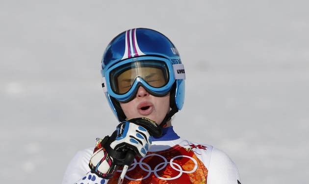 Russia's Yelena Yakovishina reacts after finishing the downhill portion of the women's supercombined in the Sochi 2014 Winter Olympics, Monday, Feb. 10, 2014, in Krasnaya Polyana, Russia.(AP Photo/Alessandro Trovati)