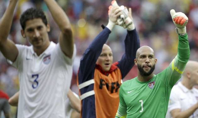 United States' goalkeeper Tim Howard (1) and his teammates celebrate after qualifying for the next World Cup round following their 1-0 loss to Germany during the group G World Cup soccer match between the USA and Germany at the Arena Pernambuco in Recife, Brazil, Thursday, June 26, 2014. (AP Photo/Ricardo Mazalan)