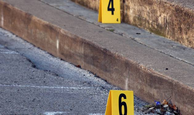 Evidence markers line Grove Street after an Assistant District Attorney was shot and killed on Thursday, Jan. 31, 2013 in downtown Kaufman, Texas. Kaufman County Assistant District Attorney Mark Hasse was shot and killed early Thursday morning as he was walking from his car to the courthouse. (AP Photo/The Dallas Morning News, David Woo) MANDATORY CREDIT; NO SALES; MAGS OUT; TV OUT; INTERNET USE BY AP MEMBERS ONLY