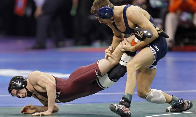 Oklahoma's Jarrod Patterson takes on Penn State's Nicholas Megaludis in the 125 pound match during the 2014 NCAA Div. 1 Wrestling Championships at Chesapeake Energy Arena in Oklahoma City, Okla. on Friday, March 21, 2014. Photo by Chris Landsberger, The Oklahoman
