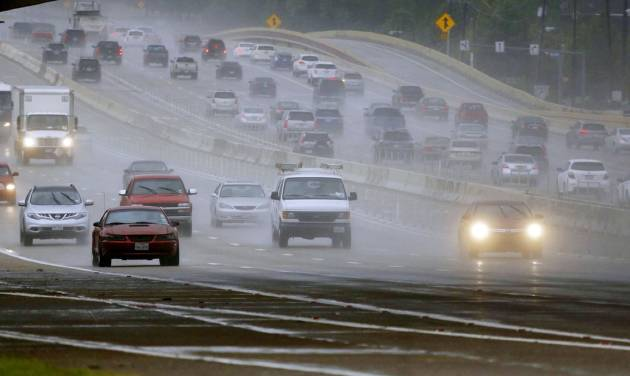 Rains pounds the Central Expressway Thursday, July 17, 2014 near the President George Bush Turnpike in Collin County, Texas. Heavy rains and localized flooding were expected as a strong storm system moved in to the region Thursday. (AP Photo/The Dallas Morning News, G.J. McCarthy)