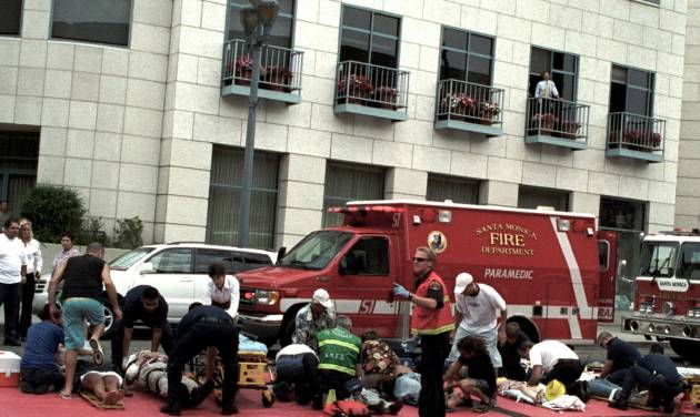 "FILE - This July 16, 2003, file photo shows emergency officials assisting injured pedestrians after a car plowed through a crowded farmers market in Santa Monica, Calif. Many motorists don't know it, but it's likely that every time they get behind the wheel there's a snitch along for the ride. In the next few days, the National Highway Traffic Safety Administration is expected to propose long-delayed regulations requiring auto manufacturers include event data recorders, better known as ""black boxes,"" in all new cars and light trucks. The NTSB has been pushing for recorders in all passenger vehicles since the board's investigation of the 2003 accident in which an elderly driver plowed through an open-air market in Santa Monica. Ten people were killed and 63 others injured. The driver refused to be interviewed and his 1992 Buick LeSabre didn't have a recorder. (AP Photo/Nate Rawner, File)"