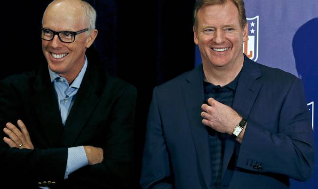 NFL Commissioner Roger Goodell, right, laughs along with Rich McKay, Atlanta Falcons president and CEO and co-chairman of the competition committee, during a news conference at the annual NFL football meetings at the Arizona Biltmore, Wednesday, March 20, 2013, in Phoenix. (AP Photo/Ross D. Franklin)