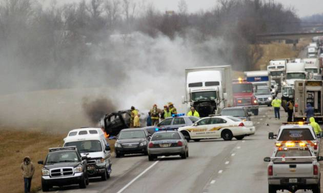 Emergency personnel work at the scene of a multi-vehicle wreck on Interstate 65 near the 82 mile marker, Saturday, March 2, 2013 north of Sonora, Ky. Kentucky State Police say six people are dead in two crashes that happened near the same location in central Kentucky on Interstate 65. (AP Photo/The News Enterprise, Neal Cardin)