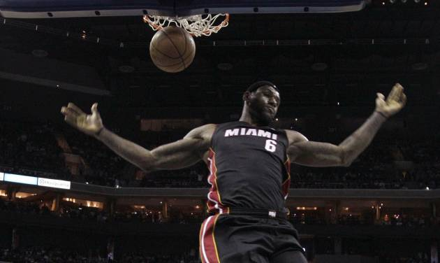 Miami Heat's LeBron James (6) reacts after dunking against the Charlotte Bobcats during the first half of an NBA basketball game in Charlotte, N.C., Saturday, Nov. 16, 2013. (AP Photo/Chuck Burton)