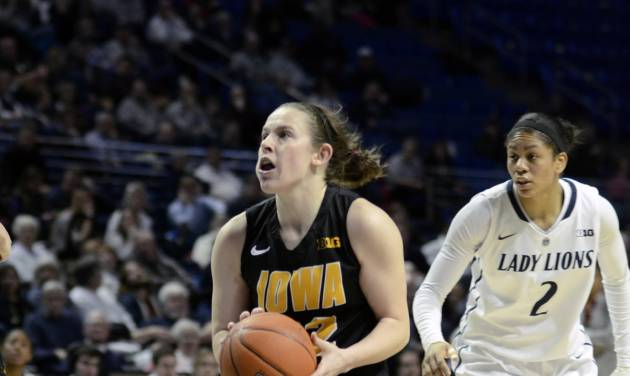 Iowa's Samantha Logic (22) moves into the paint during the second half of an NCAA college basketball game on Thursday, Feb. 6, 2014 in State College, Pa. (AP Photo/Ralph Wilson)