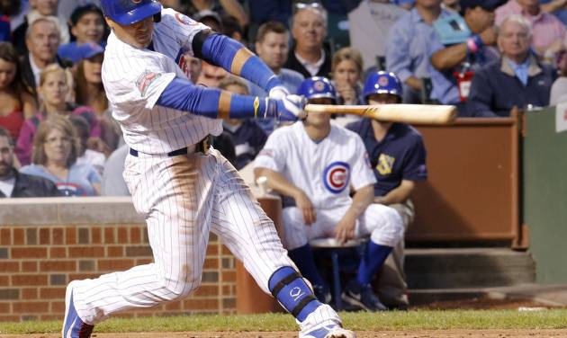 Chicago Cubs' Javier Baez follows through on a home run off Milwaukee Brewers starting pitcher Kyle Lohse during the third inning of a baseball game Wednesday, Aug. 13, 2014, in Chicago. (AP Photo/Stacy Thacker)