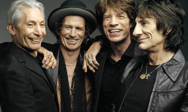 """FILE - This 2005 file photo, originally supplied by the Rolling Stones, shows members of the group, from left, Charlie Watts, Keith Richards, Mick Jagger, and Ron Wood posing during a photo shoot.  The Rolling Stones have called off their tour dates in Australia and New Zealand following the death of Mick Jagger's girlfriend and designer L'Wren Scott on Monday, March 17, 2014. The iconic band says in a statement Tuesday they """"are deeply sorry and disappointed to announce the postponement of the rest of their 14 ON FIRE tour."""" (AP Photo/The Rolling Stones, Mark Seliger-File)"""