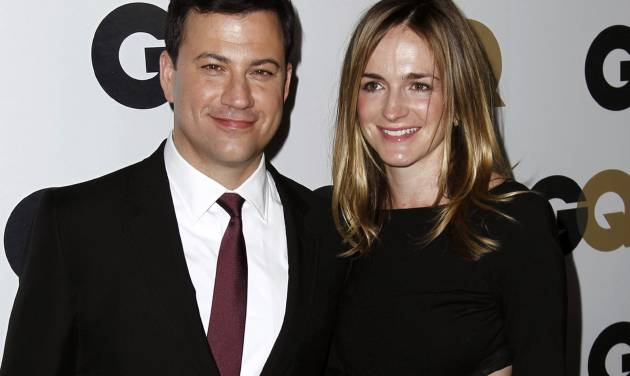 """FILE - This Nov. 17, 2011 file photo shows late night talk show host Jimmy Kimmel, left, and Molly McNearney arrive at the 16th annual GQ """"Men of the Year"""" party in Los Angeles. Kimmel and McNearney are newly engaged. His spokesman, Lewis Kay, said Wednesday, Aug. 15, 2012, that Kimmel popped the question during a recent vacation in South Africa's Kruger National Park. McNearney is the co-head writer for the network's """"Jimmy Kimmel Live."""" They started dating in 2009, after Kimmel's breakup with comic Sarah Silverman. (AP Photo/Matt Sayles)"""