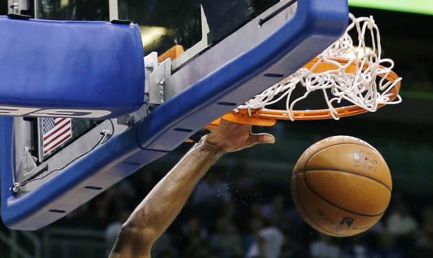 Sacramento Kings' Tyreke Evans (13) dunks on a fast break against the Orlando Magic during the first half of an NBA basketball game, Wednesday, Feb. 27, 2013, in Orlando, Fla. (AP Photo/John Raoux)