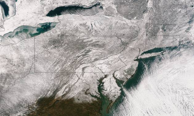 This Friday, Jan. 3, 2014 satellite image provided by the National Oceanic and Atmospheric Administration shows the blanket of snow that stretches from the Midwest across to New England after a massive winter storm moved over the region. Many areas received up to or more than a foot of snow, and the National Weather Service is warning that another system is moving across the Plains with the potential to bring more snow to the Midwest and Great Lakes regions on Jan. 4. (AP Photo/National Oceanic and Atmospheric Administration)