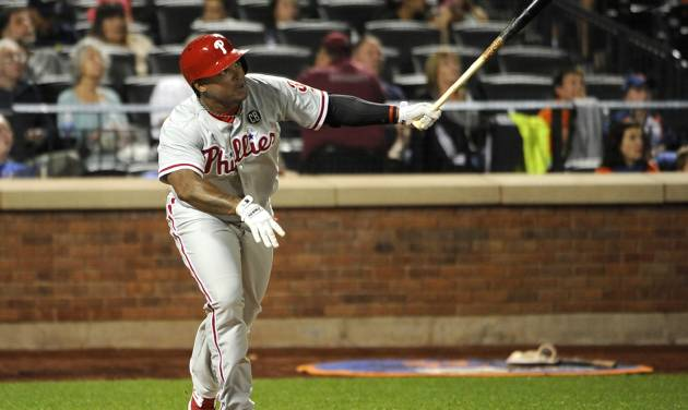 Philadelphia Phillies' Marlon Byrd watches his solo home run off of New York Mets starting pitcher Bartolo Colon in the fifth inning of a baseball game at Citi Field on Saturday, Aug. 30, 2014, in New York. (AP Photo/Kathy Kmonicek)