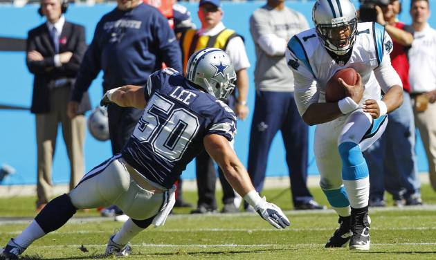 Carolina Panthers quarterback Cam Newton (1) runs as Dallas Cowboys inside linebacker Sean Lee (50) defends during the first half of an NFL football game on Sunday, Oct. 21, 2012, in Charlotte, N.C. (AP Photo/Chuck Burton)