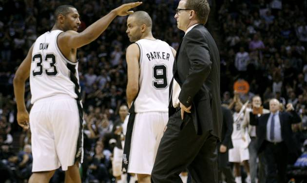 San Antonio's Boris Diaw (33) and Tony Parker (9) celebrate in front of Oklahoma City coach Scott Brooks during Game 2 of the Western Conference Finals in the NBA playoffs between the Oklahoma City Thunder and the San Antonio Spurs at the AT&T Center in San Antonio, Wednesday, May 21, 2014. Photo by Sarah Phipps, The Oklahoman