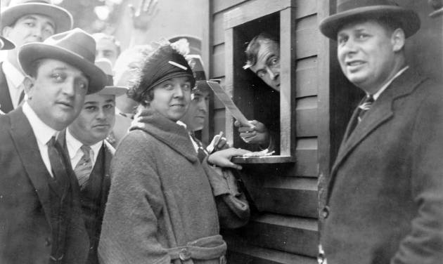 In this Oct. 1924 photo provided by the Library of Congress, Elsie Tydings waits at a ticket window, as she became the first person to purchase a ticket for a World Series baseball game in the nation's capital. The Washington Senators defeated the New York Giants in that year's series. Like this year's Washington Nationals, the 1924 World Series champion Washington Senators generated excitement in a city starved for a baseball winner. The Nats will begin their quest for the city's second championship when the playoffs begin this weekend. (AP Photo/Library of Congress)