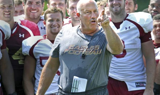 """Boston College NCAA college football head coach Steve Addazio gestures after being doused during the """"ice bucket challenge"""" on media day Thursday, Aug. 7,  2014 in Boston. (AP Photo/Boston Herald, Nancy Lane) BOSTON GLOBE OUT. METRO BOSTON NEWSPAPER OUT. MAGS OUT. ONLINE OUT."""