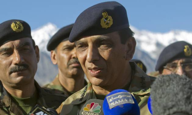 FILE - In this April 18, 2012 file photo, Pakistan's army chief Gen. Ashfaq Parvez Kayani talks with reporters after visiting a Siachen area at Skardu, Pakistan. The top U.S. commander in Afghanistan held talks with Pakistan's army chief Saturday aimed at improving border coordination, almost six months after American airstrikes accidentally killed 24 Pakistani soldiers along the frontier. (AP Photo/B.K. Bangash, File)