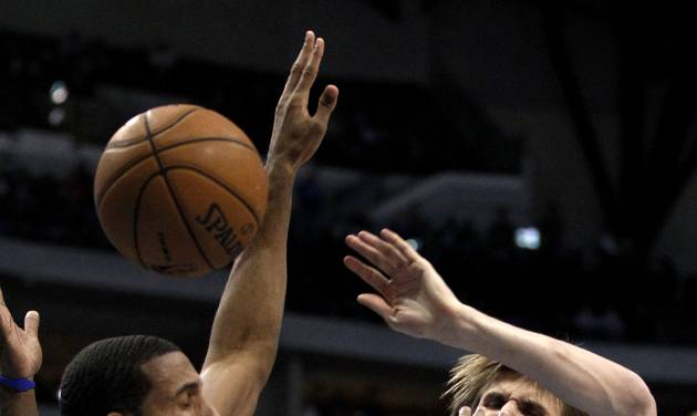 Dallas Mavericks' Brandan Wright, left, breaks up a drive to the basket by Minnesota Timberwolves' Andrei Kirilenko (47), of Russia, during the first half of an NBA basketball game, Monday, Nov. 12, 2012, in Dallas. (AP Photo/Tony Gutierrez)